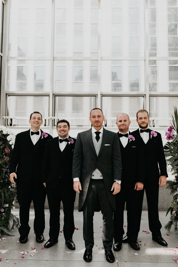 The groom was wearing a grey morning suit, the groomsmen were dressed into classic black tuxedos