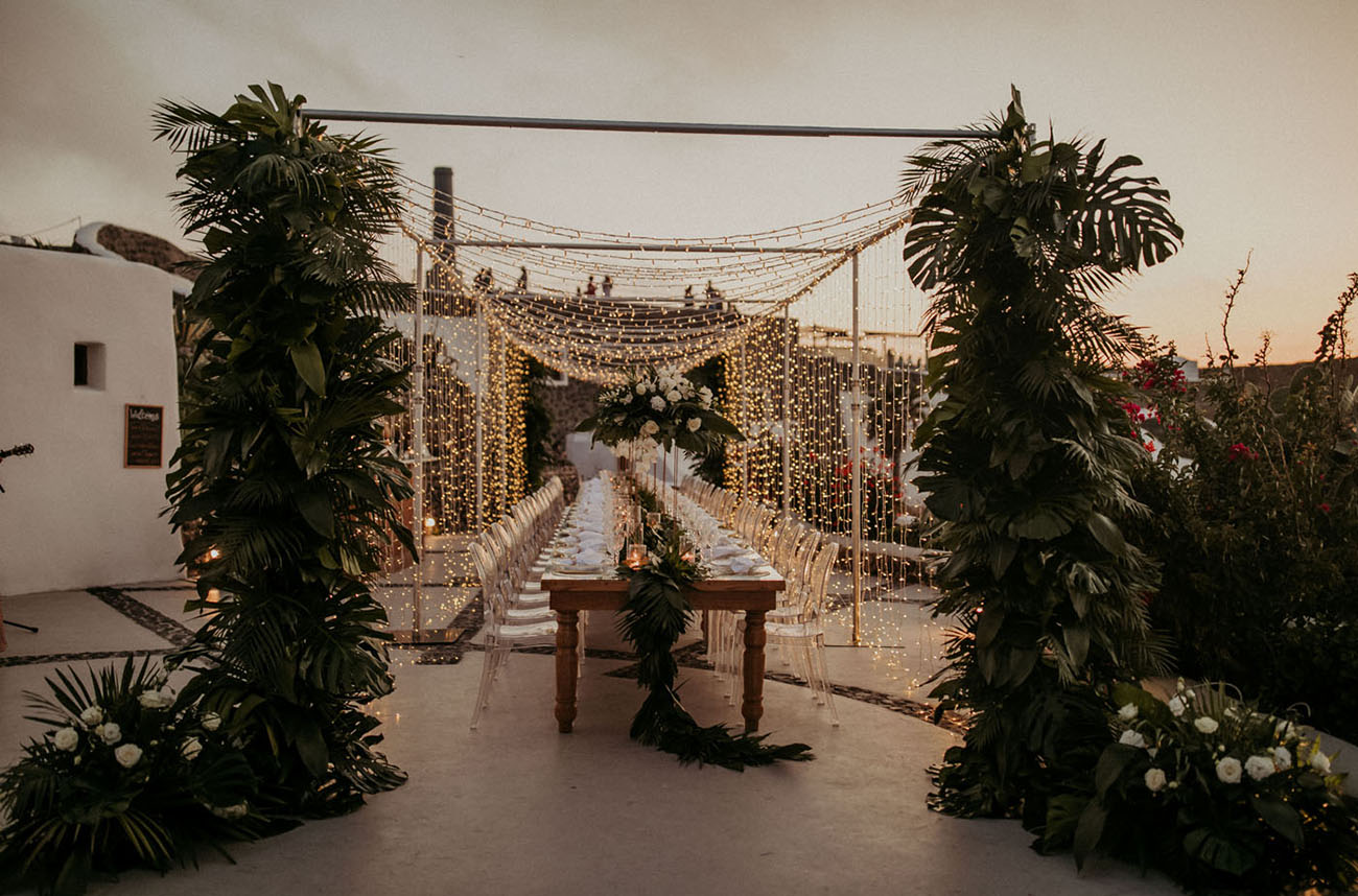The reception was done with tropical greenery and white blooms and lots of fairy lights