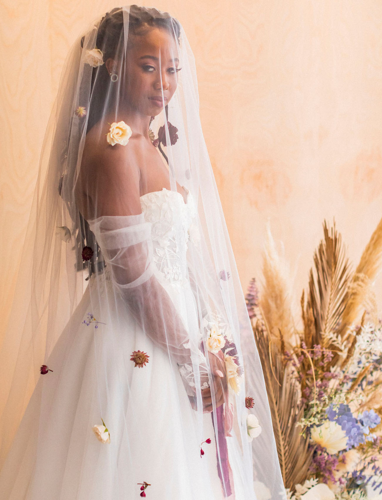 The veil was also done with dried and fresh blooms