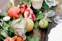 07 a wedding table runner of greenery and with fresh fall fruits is great to embrace the season