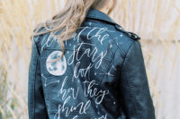 08 She covered up with a black leather jacket with a quote and a moon plus some constellations