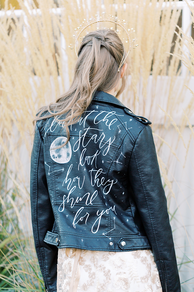 She covered up with a black leather jacket with a quote and a moon plus some constellations