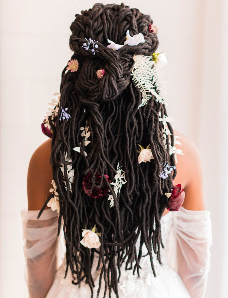 a boho bridal hairstyle with blooms