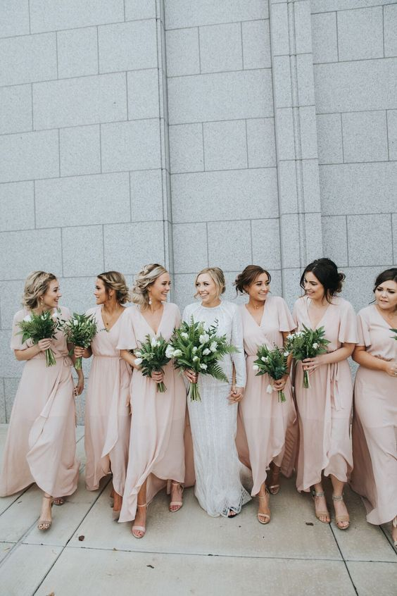 simple light pink wrap maxi bridesmaid dresses with V-necklines and short sleeves for spring or summer weddings