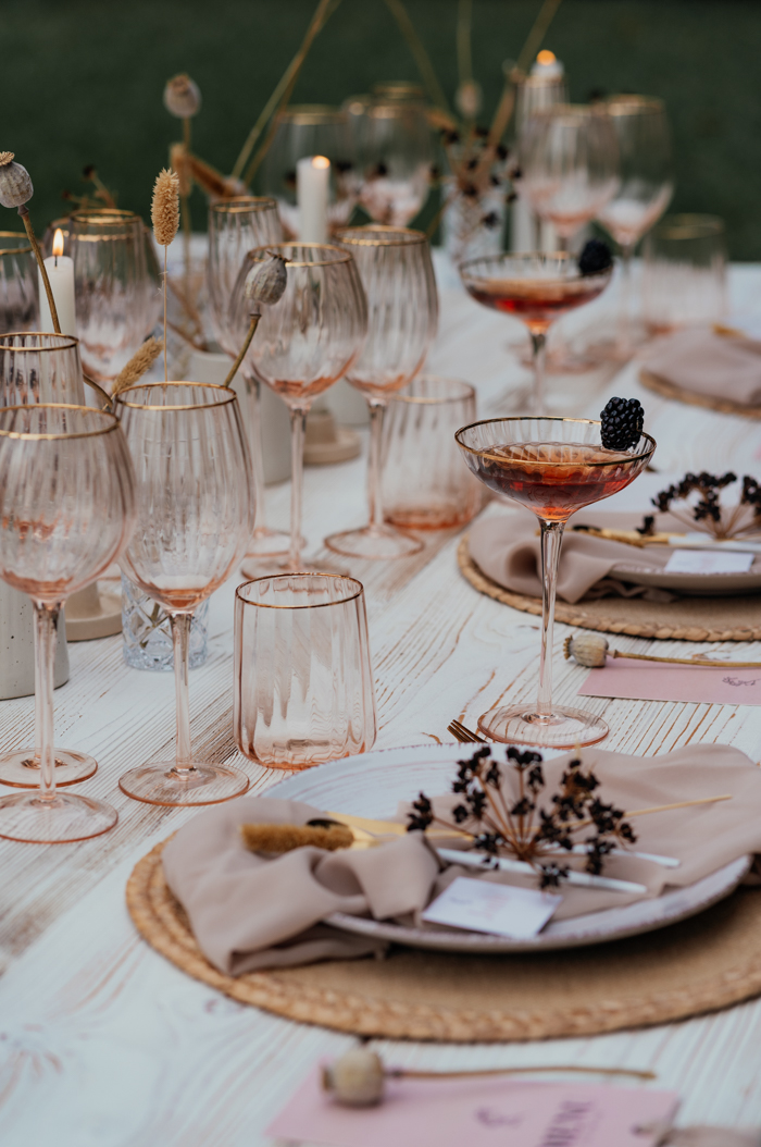 Another table was set light-colored and fresh, in blush and mauve