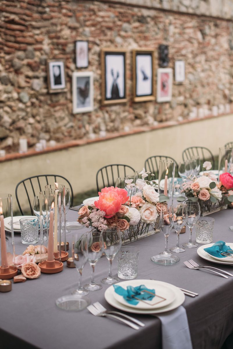 Look at the elegant blush and coral pink blooms, blush candles, turquoise bows and frames