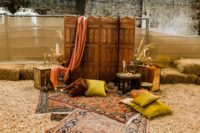 09 The lounge was truly Moroccan, with jewel tone pillows, candles and candleholders, a carved screen