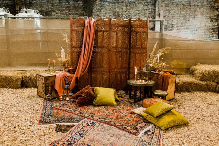 The lounge was truly Moroccan, with jewel tone pillows, candles and candleholders, a carved screen
