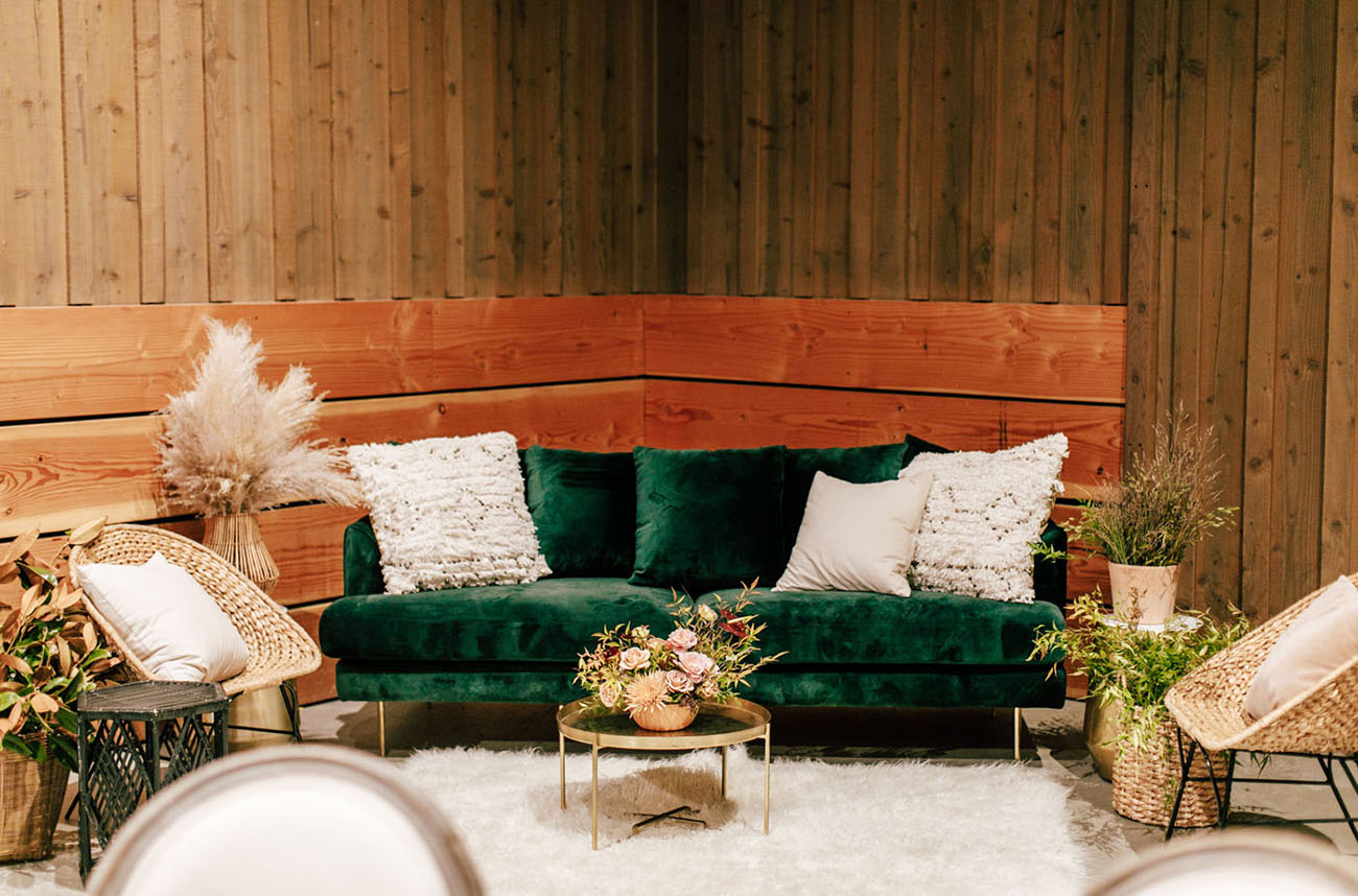 The wedding lounge was done with pampas grass, wicker furniture and gold touches