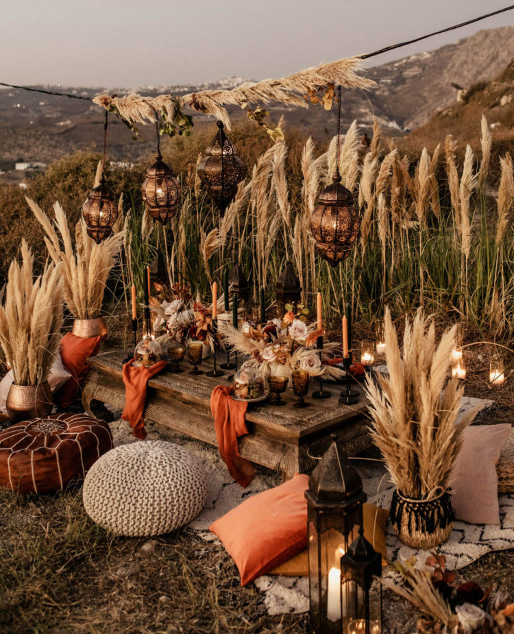 The wedding reception space was decorated with Moroccan poufs, pampas grass and lanterns