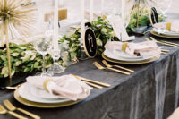 09 The wedding tablescape was done with a graphite grey tablecloth, a greenery runner, some gold touches and embroidered constellations