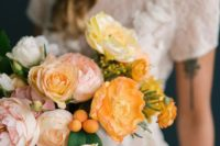 09 pastel-colored blooms paired with kumquats will make your spring wedding look bolder