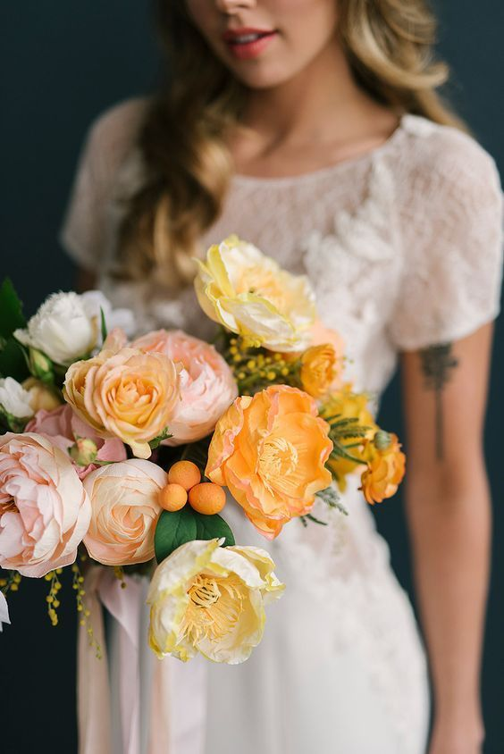 pastel-colored blooms paired with kumquats will make your spring wedding look bolder