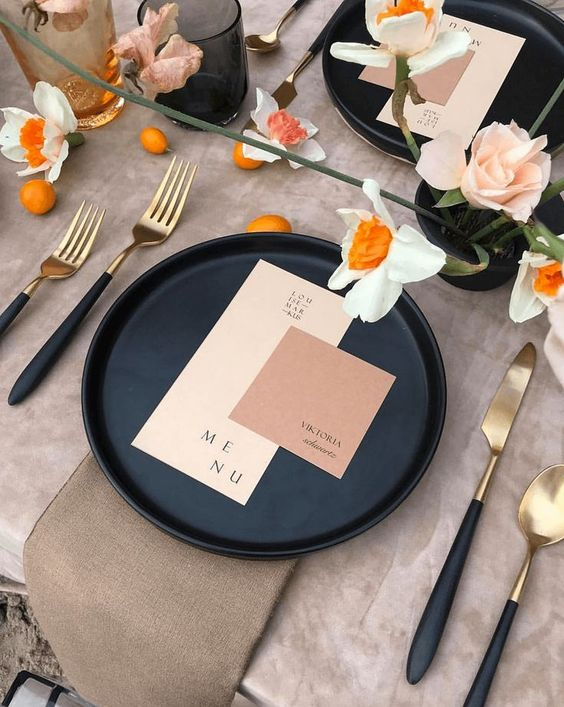 stylish color blocking -  a black charger, a blush and a dusty pink card plus some pastel blooms