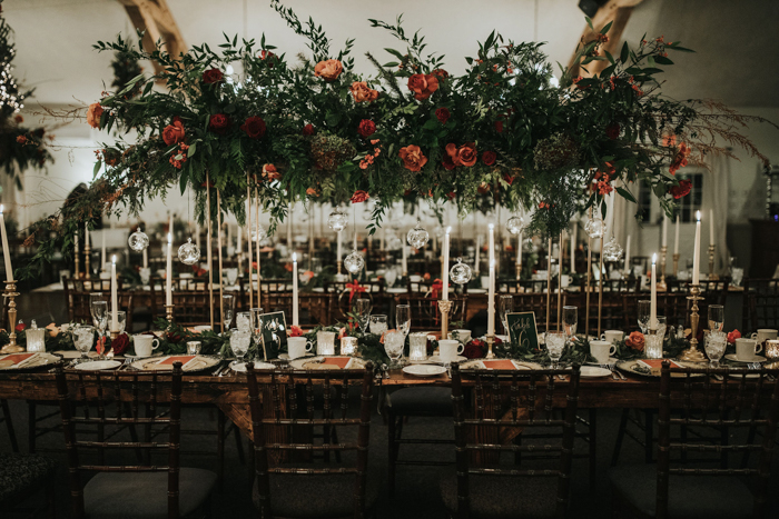 The lush greenery and florals overhead were a nice statement idea