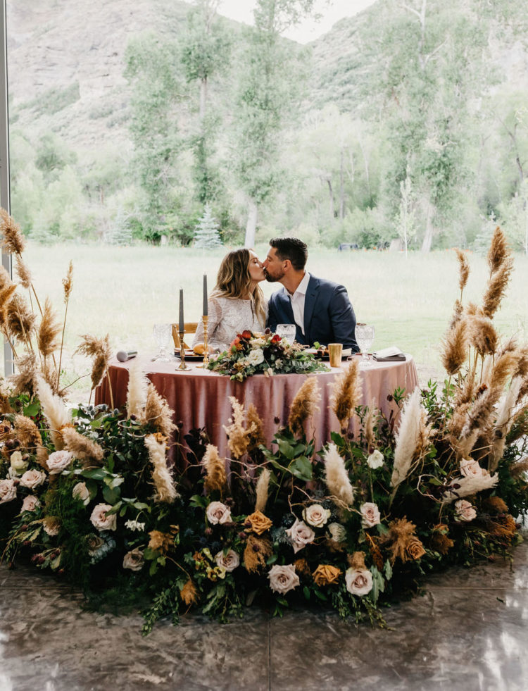 The sweetheart table was accented with the wedding altar for a chic look