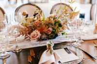 10 The wedding reception was done with lush and textural arrangements, a lace runner, glass chargers