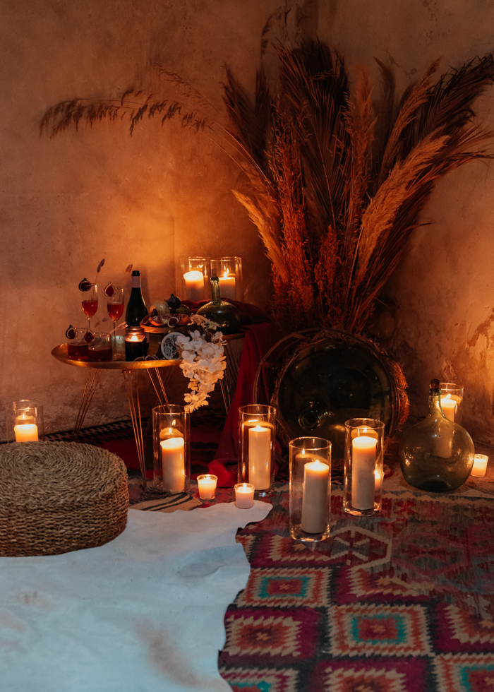 There was also a picnic space done with layered rugs, a jute ottoman, some candles and blooms and fruits