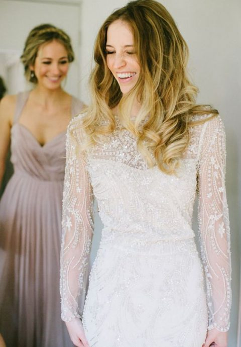 a heavily embellished sheath wedding dress with a slip underdress and intricate beading