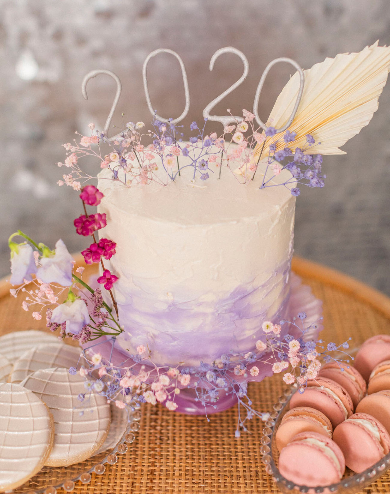 The wedding cake was an ombre lilac one, decorated with numbers and blooms