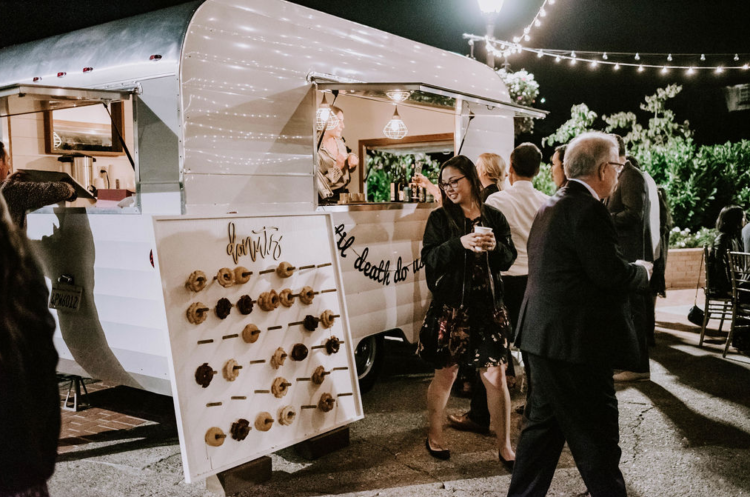 There was a trendy donut wall to skip a traditional wedding cake