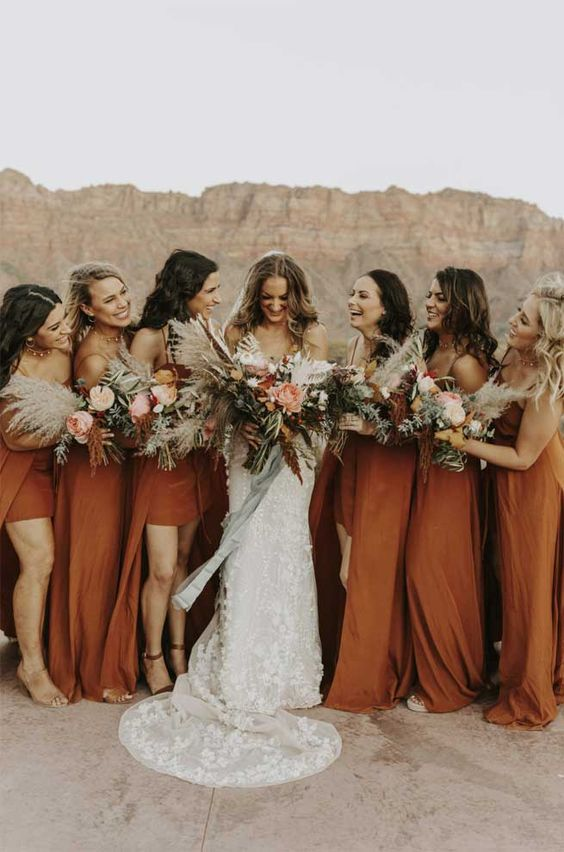 rust-colored high low bridesmaid dresses with spaghetti straps and nude shoes for a trendy look