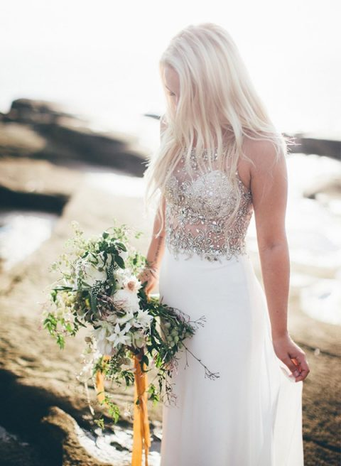 a stunning sheath wedding gown with a plain skirt and a heavily embellished illusion bodice