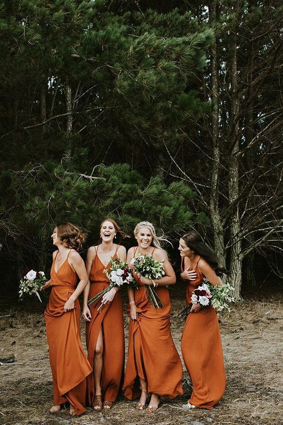 rust-colored slip bridesmaid dresses with spaghetti straps and front slits for a bold look