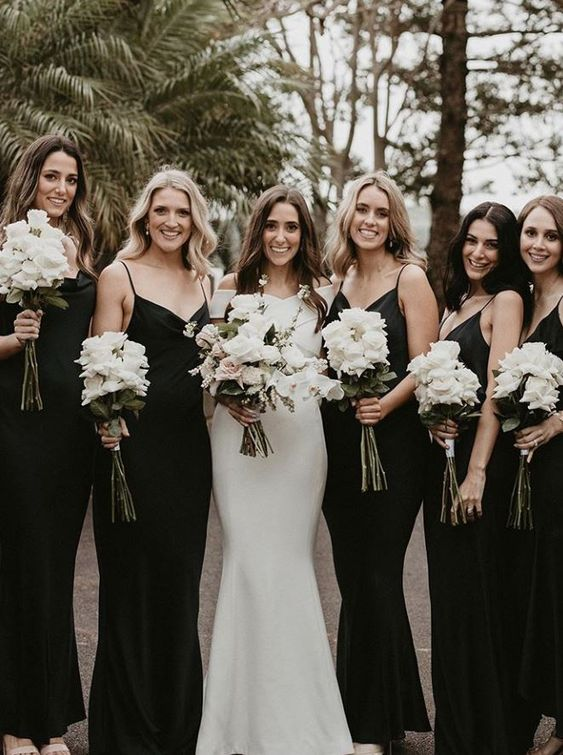 black slip maxi bridesmaid dresses with V-necklines and slight mermaid silhouettes