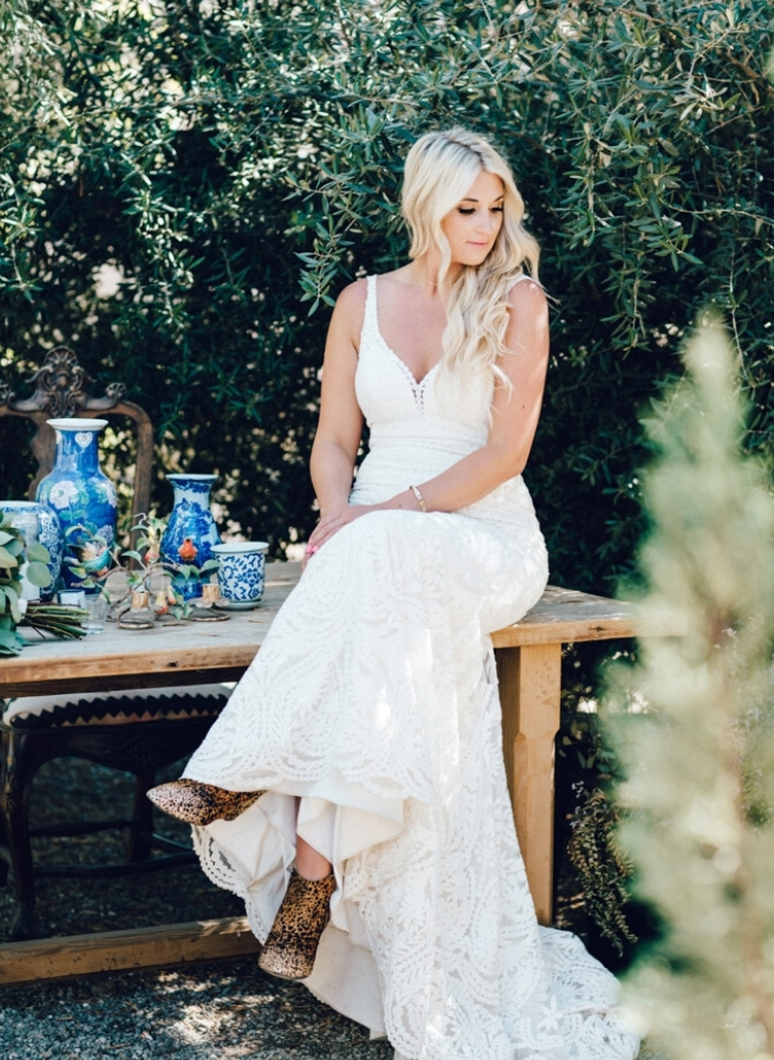 a white lace wedding dress and leopard print boots to contrast and to make you look bright and chic