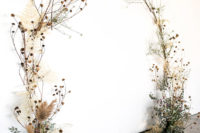 19 a fantastic wedding ceremony arch of eucalyptus, dried leaves and herbs plus dried billy balls looks ethereal and delicate