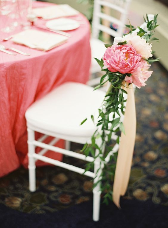 a sherbet pink tablecloth and a matching bloom on the chair is a cool idea for a trendy touch