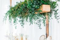 22 a hanging wooden box with lush greenery will instantly add freshness to the reception