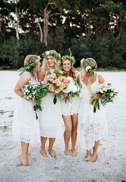 mismatching white lace bridesmaid dresses are perfect for a boho beach wedding
