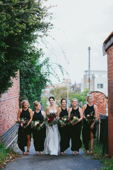 black halter neckline maxi bridesmaid dresses with slits paired with black shoes are elegant