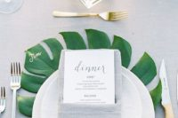 31 mark each place setting with a large palm leaf to make it stand out and add coloring to the table