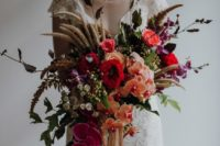 32 a super colorful statement wedding bouquet with much texture and a creative shape wows