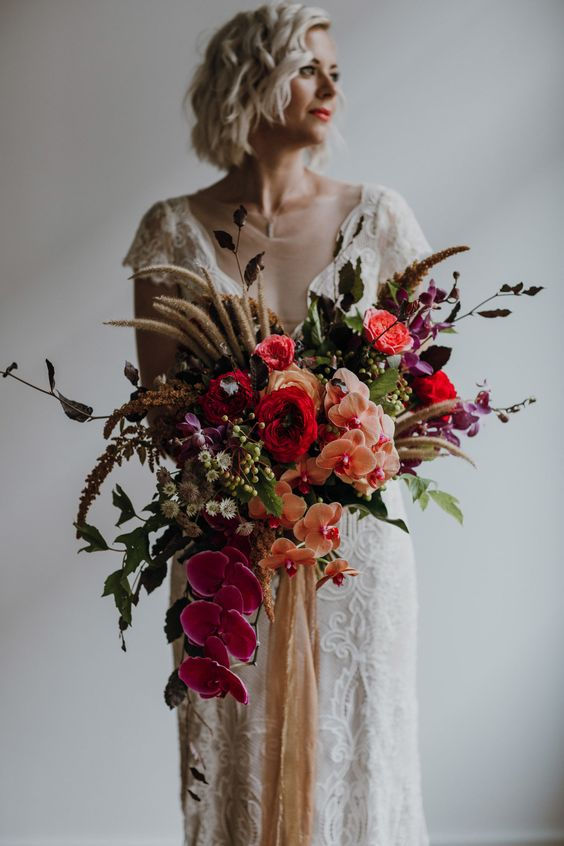 a super colorful statement wedding bouquet with much texture and a creative shape wows