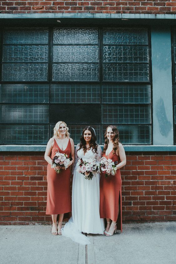 terracotta strap midi bridesmaid dresses with a deep neckline and nude shoes