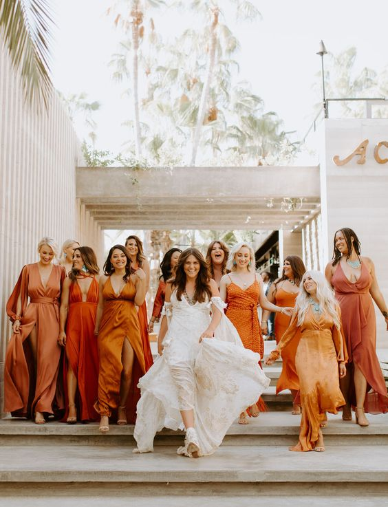 mismatching bridesmaid dresses in all shades of terracotta are a very trendy and edgy idea
