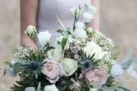 35 an oversized pastel wedding bouquet with blush and white roses, thistles and greenery