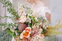 36 an oversized wedding bouquetin pink shades and lush textural greenery plus yellow herbs