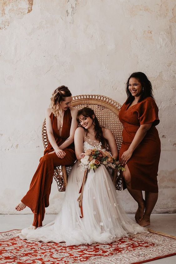 mismatching terracotta bridesmaid dresses with various designs, cuts and lengths are cool