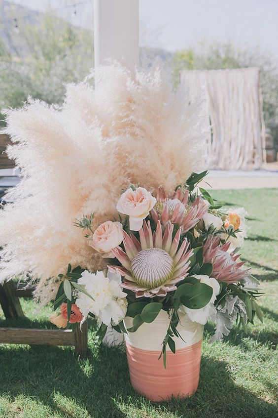 lush pampas and floral decor is amazing for the wedding aisle