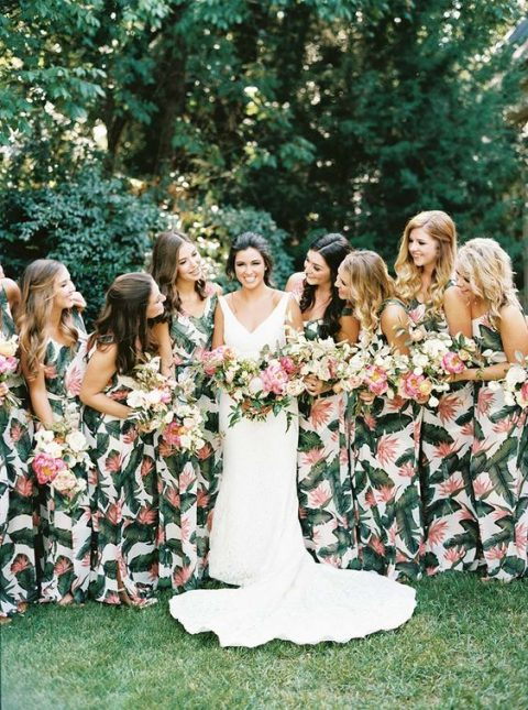 matching thick strap maxi bridesmaid dresses with tropical leaf prints are a timeless idea