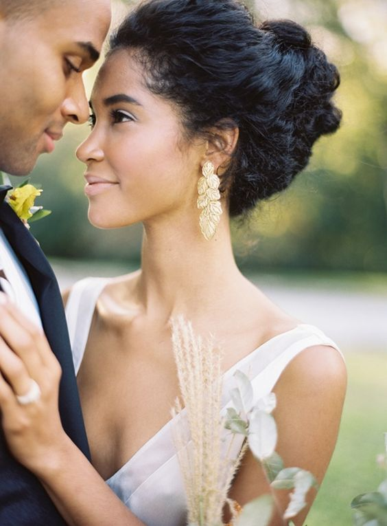 a chic wedding updo of more or less straight hair but with plenty of texture and a bump on top
