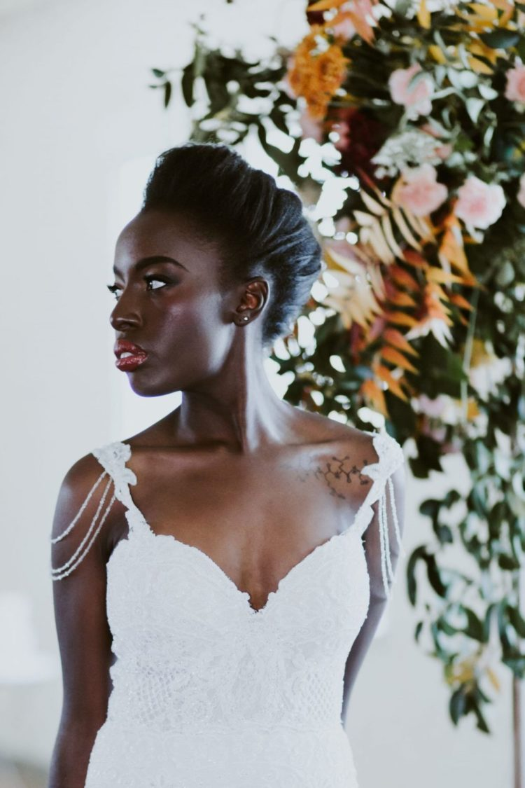 a stylish and voluminous wedding updo of straight hair is a chic idea for a formal wedding