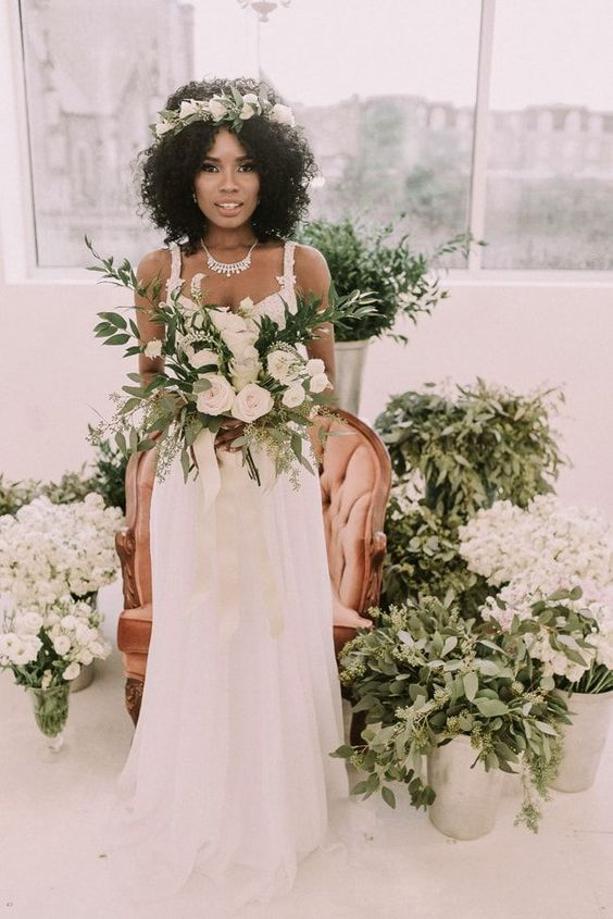 natural curls accented with a fresh flower crown is an effortless idea for your wedding day