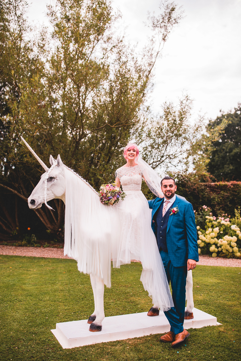 This couple went for a super funny and colorful wedding with a unicorn, which was the theme of the celebration