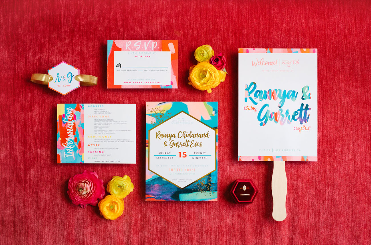 The colorful wedding stationery was created by the bride herself as she's an artist